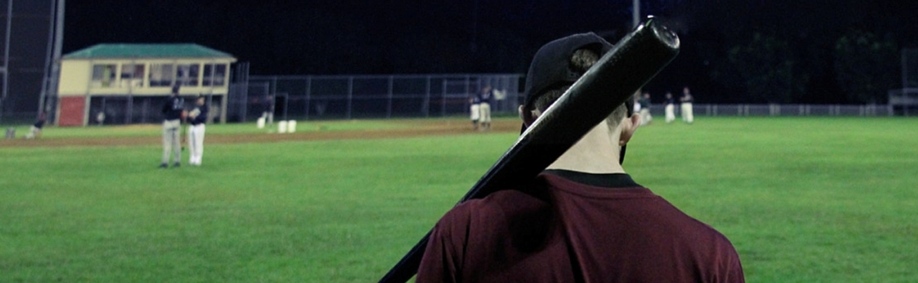 Baseball player with a bat on his shoulder.