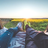 Man and woman relaxing in a field.
